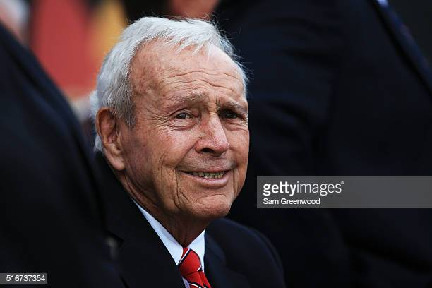 Arnold Palmer watches action on the 18th green during the final round of the Arnold Palmer Invitational Presented by MasterCard at Bay Hill Club and...