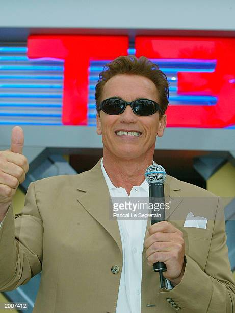Arnold Scharzenegger talks to the crowd during the photocall for the film 'Terminator 3' at the Carlton Hotel during the 56th International Cannes...