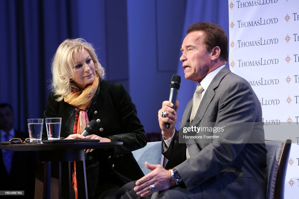 Arnold Schwarzenegger, actor and former Governor of California, and moderator Sabine Christiansen attend the Lloyd Cleantech Congress on February 1, 2013 in Frankfurt am Main, Germany. The Thomas Lloyd Group invited Investors and guests to discuss actual technologies and trends in renewable energies.