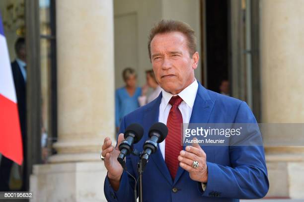 Arnold Schwarzenegger addresses the press as he leaves after meeting French President Emmanuel Macron at the Elysee Palace on June 23 2017 in Paris...