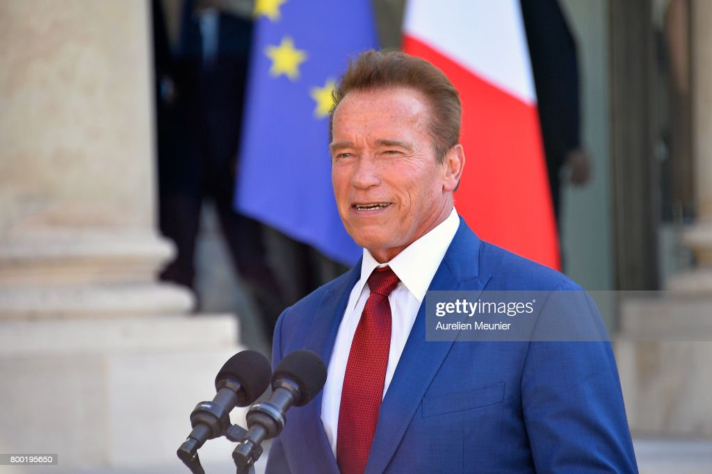 Arnold Schwarzenegger addresses the press as he leaves after meeting French President Emmanuel Macron at the Elysee Palace on June 23, 2017 in Paris, France. On their agenda was the United States withdrawal from the COP 21 and global climate change.