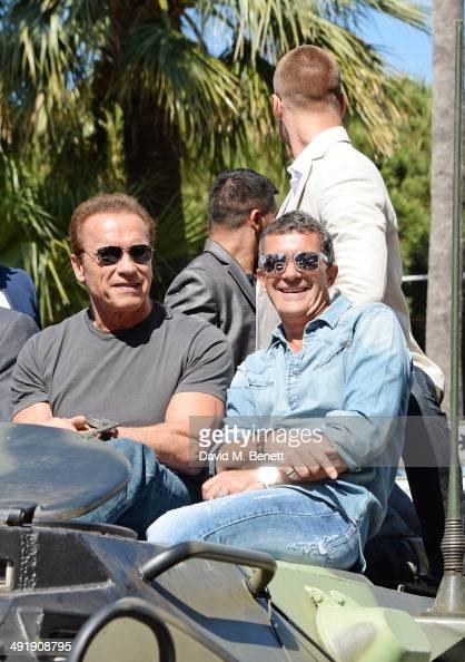 Arnold Schwarzenegger and Antonio Banderas attend a photocall for 'The Expendables 3' at the Carlton Hotel on May 18 2014 in Cannes France