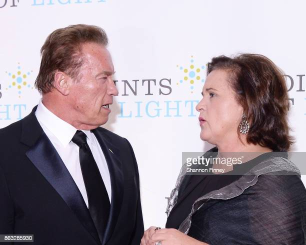 Arnold Schwarzenegger and Dorothy Bush Koch greet each other at the 2017 Points of Light Gala at the French Embassy on October 19 2017 in Washington...