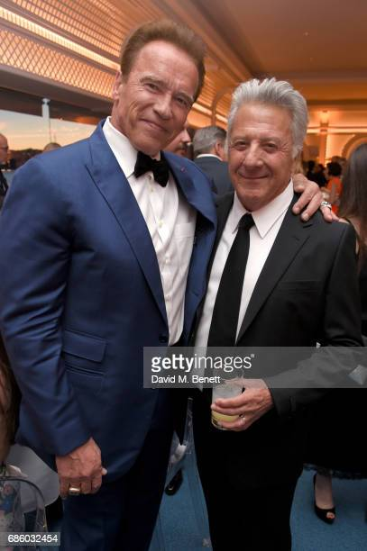 Arnold Schwarzenegger and Dustin Hoffman attend the Vanity Fair and HBO Dinner celebrating the Cannes Film Festival at Hotel du CapEdenRoc on May 20...