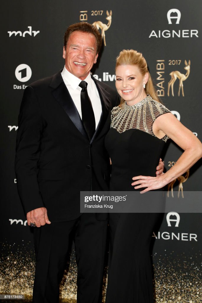 Arnold Schwarzenegger and his partner Heather Milligan arrive at the Bambi Awards 2017 at Stage Theater on November 16, 2017 in Berlin, Germany.