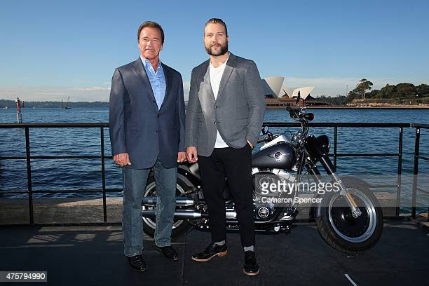 Arnold Schwarzenegger and Jai Courtney pose during a 'Terminator Genisys' photo call at the Park Hyatt Sydney on June 4 2015 in Sydney Australia
