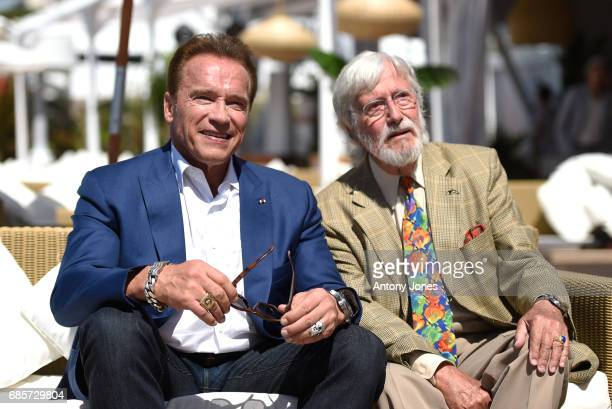 Arnold Schwarzenegger and JeanMichel Cousteau attend photocall for 'Wonders of the Sea 3D' during the 70th annual Cannes Film Festival at Nikki Beach...
