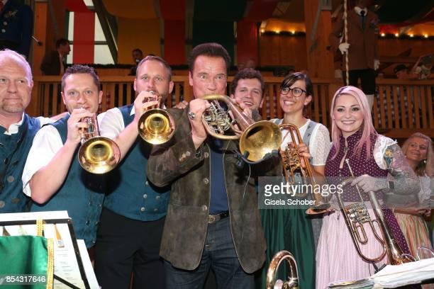 Arnold Schwarzenegger and musicians of the orchestra during the Oktoberfest at Schuetzen Festzelt at Theresienwiese on September 26 2017 in Munich...