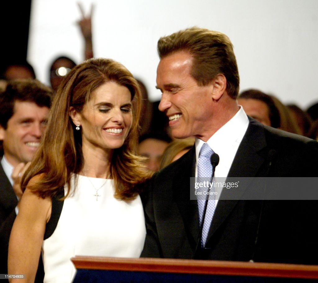 Arnold Schwarzenegger and wife Maria Shriver are applauded at his victory celebration after winning the California recall election in Los Angeles...