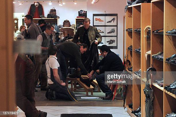 Arnold Schwarzenegger buys shoes in an old established footware store on January 20 2012 in Kitzbuehel Austria