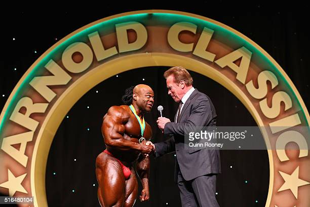 Arnold Schwarzenegger congratulates Kai Greene of the United States for winning the Arnold Classic Mens Bodybuilding Open during the 2016 Arnold...