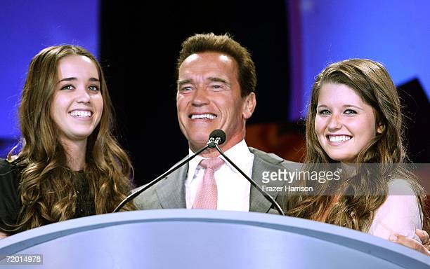 Arnold Schwarzenegger Governor of California appears on stage with his two daughters Katherine Schwarzenegger and Christina Schwarzenegger on stage...