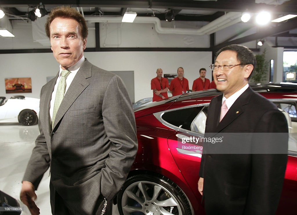 Arnold Schwarzenegger, governor of California, left, and Akio Toyoda, president of Toyota Motor Corp., tour the Tesla Motors Inc. headquarters in Palo Alto, California, U.S., on Thursday, May 20, 2010. Toyota Motor Corp. will acquire a $50 million stake in California electric-car maker Tesla Motors Inc. as automakers compete to introduce less-polluting vehicles in the U.S. Photographer: Tony Avelar/Bloomberg via Getty Images