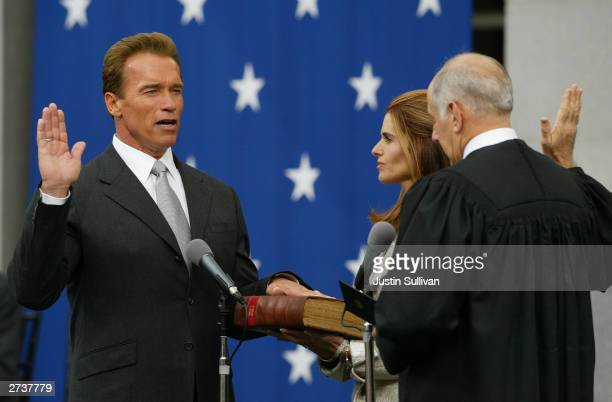 Arnold Schwarzenegger is sworn in as the 38th governor of California by California Chief Justice Ronald George as Schwarzenegger's wife Maria Shriver...