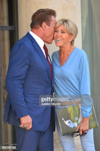 Arnold Schwarzenegger kisses Brigitte Macron after meeting with French President Emmanuel Macron at the Elysee Palace on June 23 2017 in Paris France...