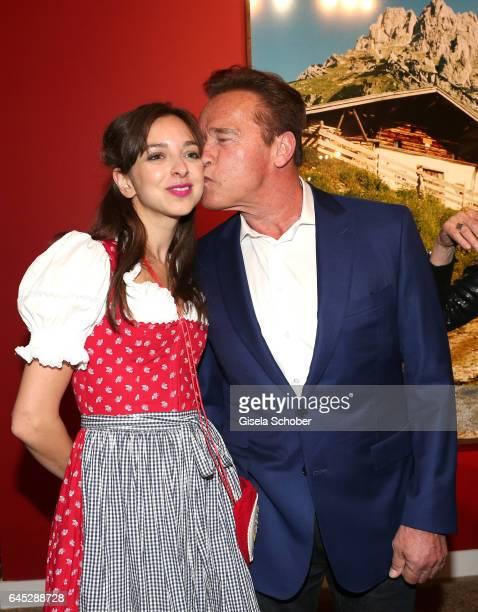 Arnold Schwarzenegger kisses Charlotte Taschen during the opening night of Ellen von Unwerth's photo exhibition at TASCHEN Gallery on February 24...