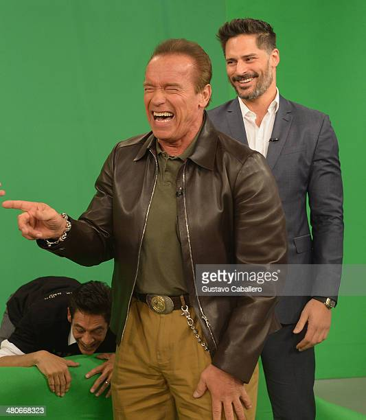 Arnold Schwarzenegger laughs whilst on the set of Despierta America with Joe Manganiello at Univision Headquarters on March 26 2014 in Miami Florida