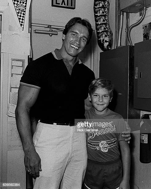 Arnold Schwarzenegger meets fans and Autographs his workout record at Record Bar in Atlanta Georgia August 4 1984