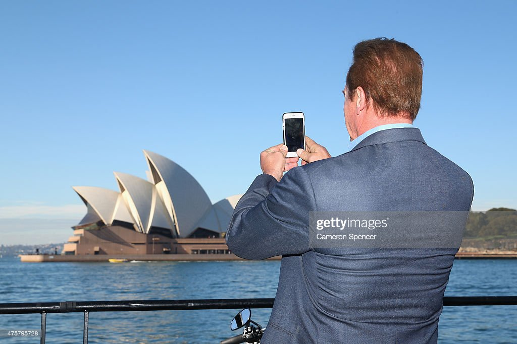 Arnold Schwarzenegger poses in front of his iPhone during a 'Terminator Genisys' photo call at the Park Hyatt Sydney on June 4, 2015 in Sydney, Australia.