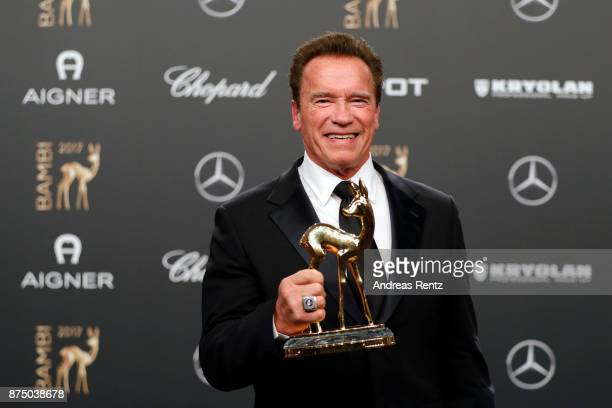 Arnold Schwarzenegger poses with award at the Bambi Awards 2017 winners board at Stage Theater on November 16 2017 in Berlin Germany