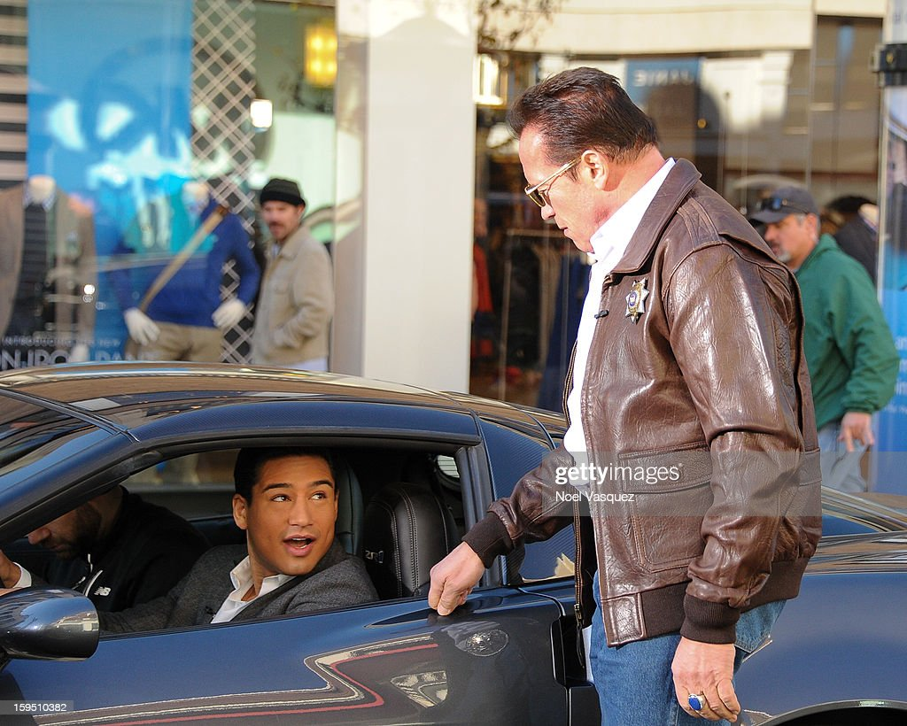 <a gi-track='captionPersonalityLinkClicked' href=/galleries/search?phrase=Arnold+Schwarzenegger&family=editorial&specificpeople=156406 ng-click='$event.stopPropagation()'>Arnold Schwarzenegger</a> (R) pulls over <a gi-track='captionPersonalityLinkClicked' href=/galleries/search?phrase=Mario+Lopez&family=editorial&specificpeople=235992 ng-click='$event.stopPropagation()'>Mario Lopez</a> at Extra at The Grove on January 14, 2013 in Los Angeles, California.