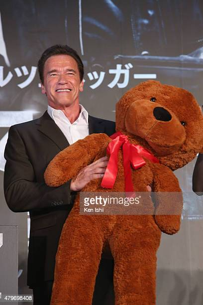 Arnold Schwarzenegger receives a teddy bear during the Tokyo Premiere of 'Terminator Genisys' at the Roppongi Hills Arena on July 6 2015 in Tokyo...