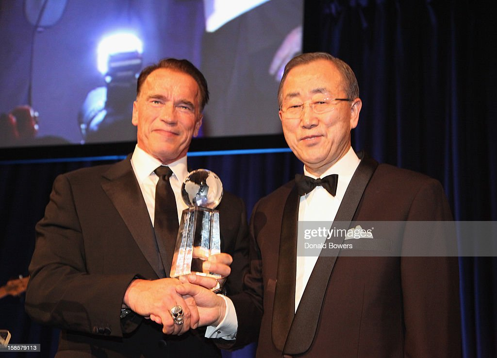 Arnold Schwarzenegger receives an award from UN Secretary-General Ban Ki-Moon for the 2012 Global Advocate of the Year from the United Nations Correspondents Association at Cipriani 42nd Street on December 19, 2012 in New York City.