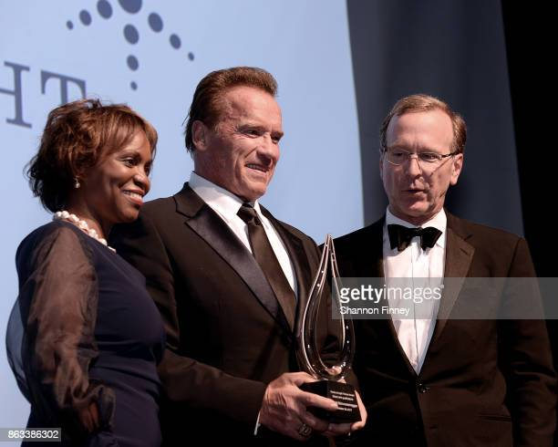 Arnold Schwarzenegger receives the 2017 Points of Light Tribute Award from Natalye Paquin CEO of Points of Light and board chairman Neil Bush at the...