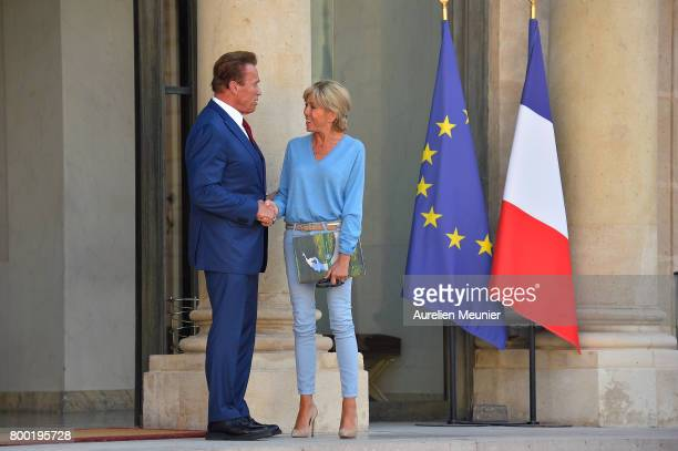 Arnold Schwarzenegger shakes hand with Brigitte Macron after meeting with French President Emmanuel Macron at the Elysee Palace on June 23 2017 in...