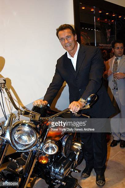 Arnold Schwarzenegger shows off an Indian Chief T3 limited edition motorcycle during the grand opening of Audemars Piguet's new flagship store on E...