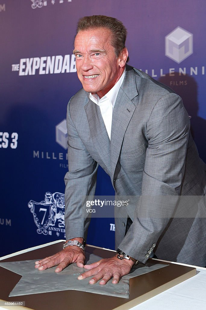 <a gi-track='captionPersonalityLinkClicked' href=/galleries/search?phrase=Arnold+Schwarzenegger&family=editorial&specificpeople=156406 ng-click='$event.stopPropagation()'>Arnold Schwarzenegger</a> shows off his hand print during a photocall at a special screening of 'The Expendables 3' at The Venetian Macao on August 22, 2014 in Macau, Macau.