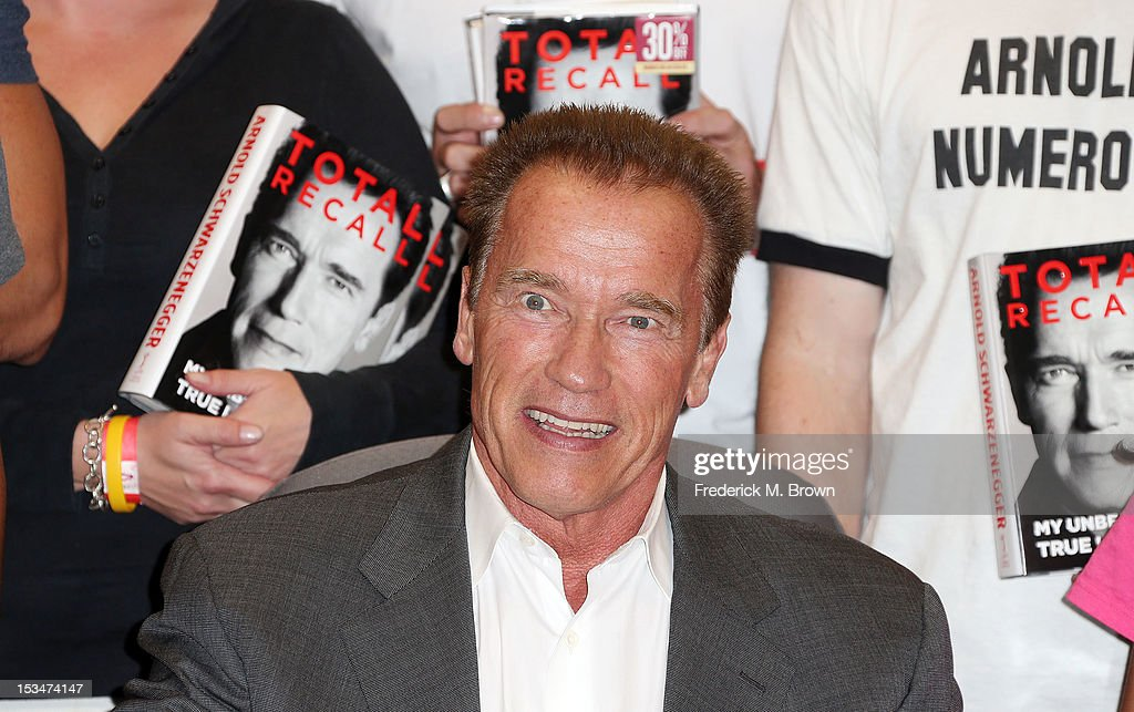 <a gi-track='captionPersonalityLinkClicked' href=/galleries/search?phrase=Arnold+Schwarzenegger&family=editorial&specificpeople=156406 ng-click='$event.stopPropagation()'>Arnold Schwarzenegger</a> smiles during <a gi-track='captionPersonalityLinkClicked' href=/galleries/search?phrase=Arnold+Schwarzenegger&family=editorial&specificpeople=156406 ng-click='$event.stopPropagation()'>Arnold Schwarzenegger</a> Book Signing For 'Total Recall' at Barnes & Noble bookstore at The Grove on October 5, 2012 in Los Angeles, California.