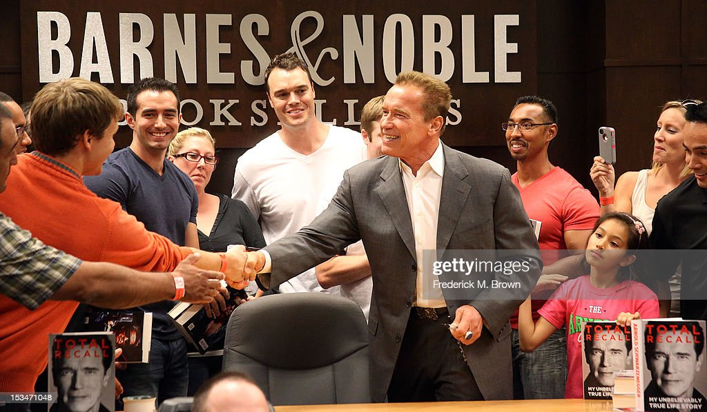 <a gi-track='captionPersonalityLinkClicked' href=/galleries/search?phrase=Arnold+Schwarzenegger&family=editorial&specificpeople=156406 ng-click='$event.stopPropagation()'>Arnold Schwarzenegger</a> smiles during his book signing for 'Total Recall' at Barnes & Noble bookstore at The Grove on October 5, 2012 in Los Angeles, California.