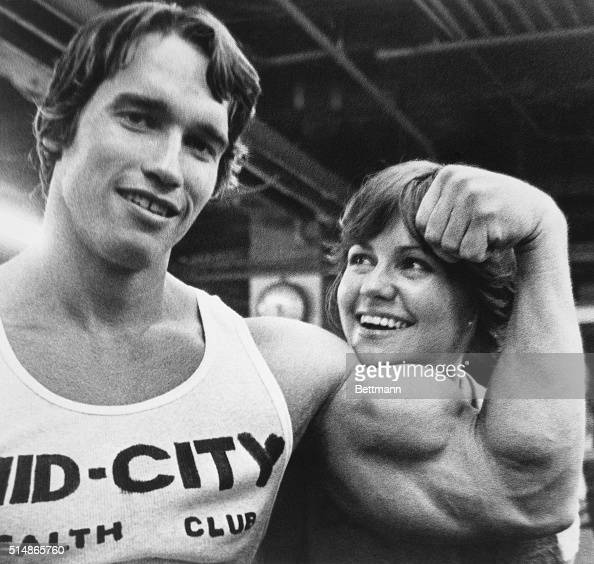 Arnold Schwarzenegger supplies a chinrest for Sally Field as they take a break from a bodybuilding workout session here 4/20 They began the exercise...