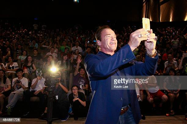 Arnold Schwarzenegger takes a selfie with audience at the first screenings of Terminator Genisys at Palace IAPM on August 22 2015 in Shanghai China