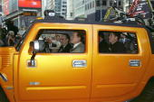 Arnold Schwarzenegger takes Mayor Giuliani for a 'ride' in Times Square where the actor was plugging a new Hummer sports utility truck Schwarzenegger...