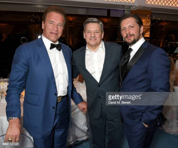 Arnold Schwarzenegger Ted Sarandos and Michele Malenotti attend the Vanity Fair and HBO Dinner celebrating the Cannes Film Festival at Hotel du...