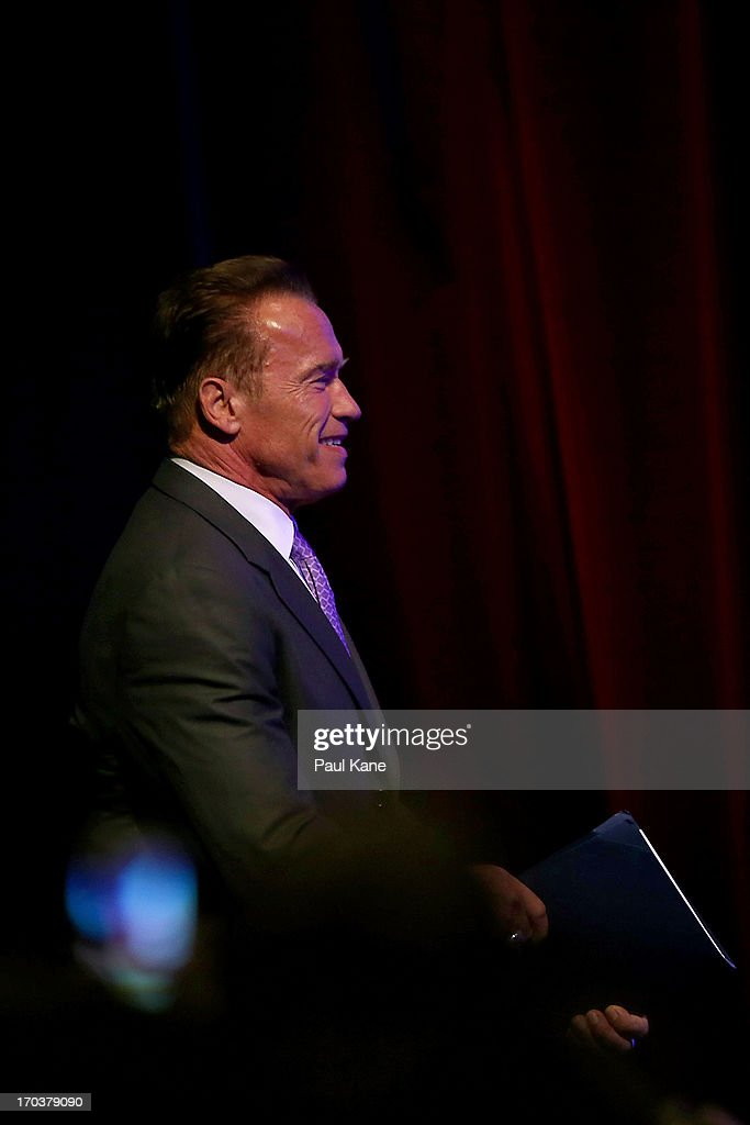 <a gi-track='captionPersonalityLinkClicked' href=/galleries/search?phrase=Arnold+Schwarzenegger&family=editorial&specificpeople=156406 ng-click='$event.stopPropagation()'>Arnold Schwarzenegger</a> walks onto the stage to speak at the 2013 Financial Education Summit at the Perth Convention and Exhibition Centre on June 12, 2013 in Perth, Australia.