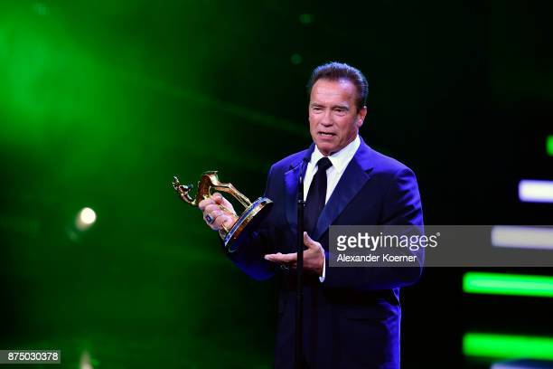 Arnold Schwarzenegger with his Bambi on stage during the Bambi Awards 2017 show at Stage Theater on November 16 2017 in Berlin Germany