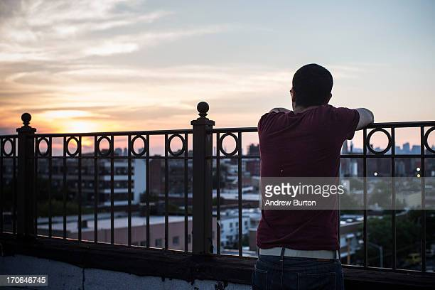 Arnon Schottenfels looks out at the New York skyline from an undisclosed rooftop on June 15 2013 in the Brooklyn Borough of New York City The project...