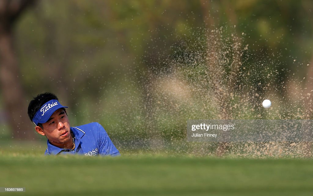 Arnond Vongvanij of Thailand plays out of a bunker during day one of the Avantha Masters at Jaypee Greens Golf Club on March 14, 2013 in Delhi, India.