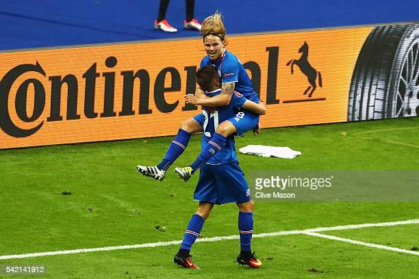 Arnor Ingvi Traustason of Iceland and Birkir Bjarnason of Iceland celebrate the winning goal during the UEFA EURO 2016 Group F match between Iceland...