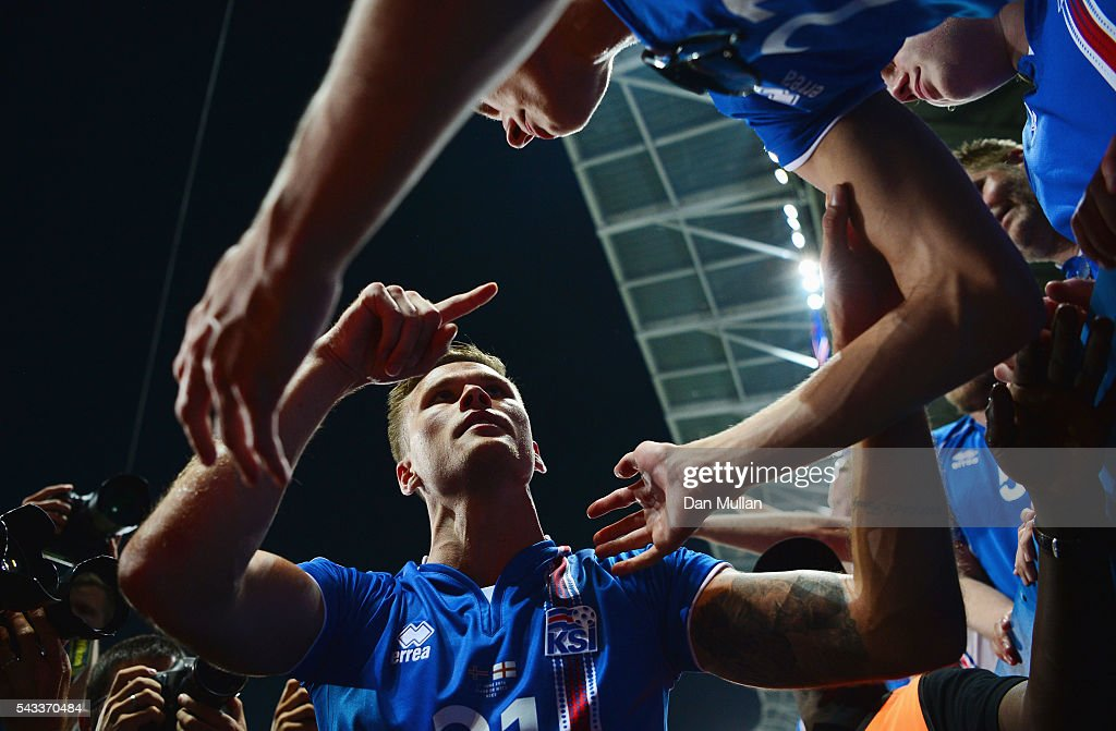 Arnor Ingvi Traustason of Iceland celebrates the win with supporters after the UEFA EURO 2016 round of 16 match between England and Iceland at Allianz Riviera Stadium on June 27, 2016 in Nice, France.