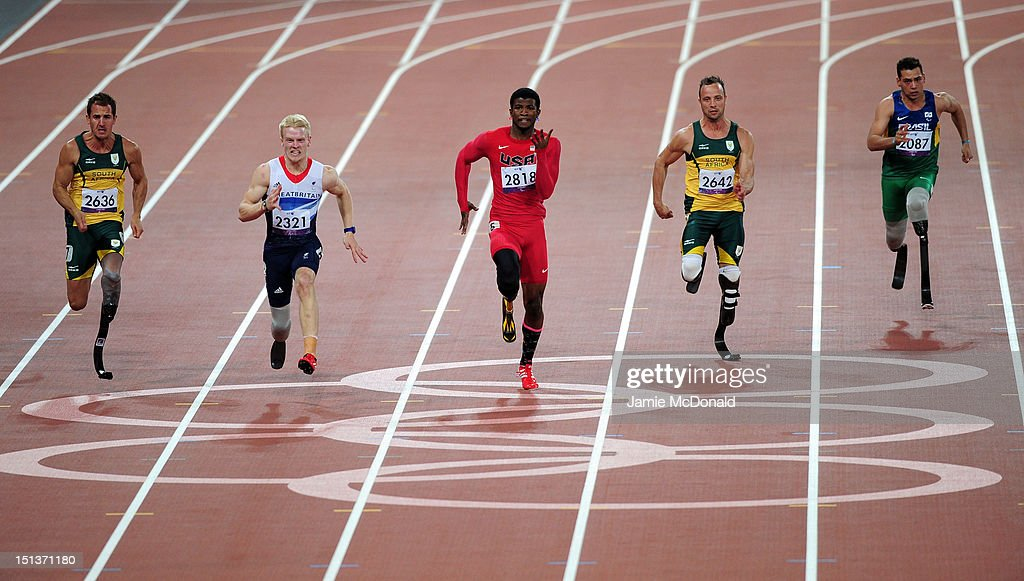 Arnu Fourie of South Africa, Jonnie Peacock of Great Britain, Richard Browne of the United States, Oscar Pistorius of South Africa and Alan Fonteles Cardoso Oliveira of Brazil compete in the Men's 100m - T44 Final on day 8 of the London 2012 Paralympic Games at Olympic Stadium on September 6, 2012 in London, England.