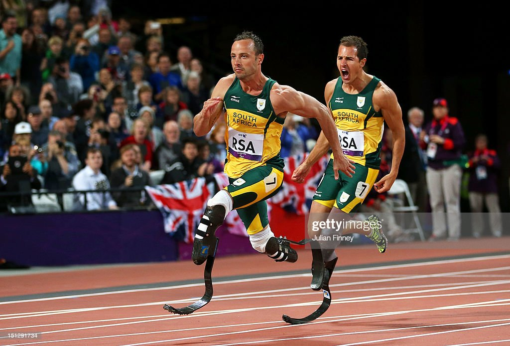 Arnu Fourie passes over to last leg <a gi-track='captionPersonalityLinkClicked' href=/galleries/search?phrase=Oscar+Pistorius&family=editorial&specificpeople=224406 ng-click='$event.stopPropagation()'>Oscar Pistorius</a> of South Africa in the Men's 4x100m relay T42/T46 Final on day 7 of the London 2012 Paralympic Games at Olympic Stadium on September 5, 2012 in London, England.