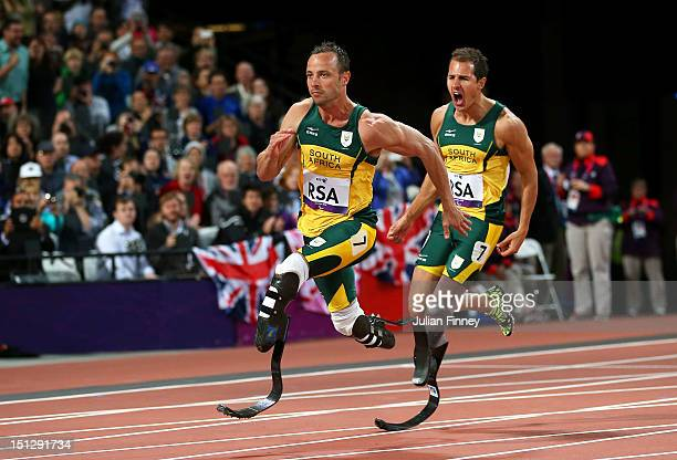 Arnu Fourie passes over to last leg Oscar Pistorius of South Africa in the Men's 4x100m relay T42/T46 Final on day 7 of the London 2012 Paralympic...
