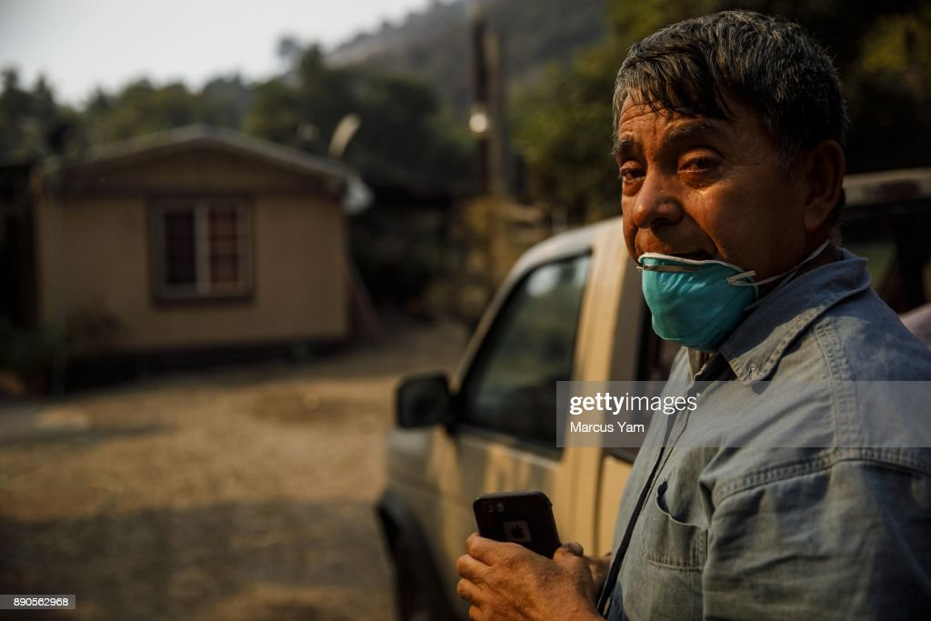 CARPINTERIA, CALIF. -- MONDAY, DECEMBER 11, 2017: Arnulfo Basabe breaks down, weeps and pray after his discovers that his trailer home is still standing in a Stanley Park Road neighborhood that has been mostly destroyed by the Thomas Fire, near Carpinteria, Calif., on Dec. 11, 2017.
