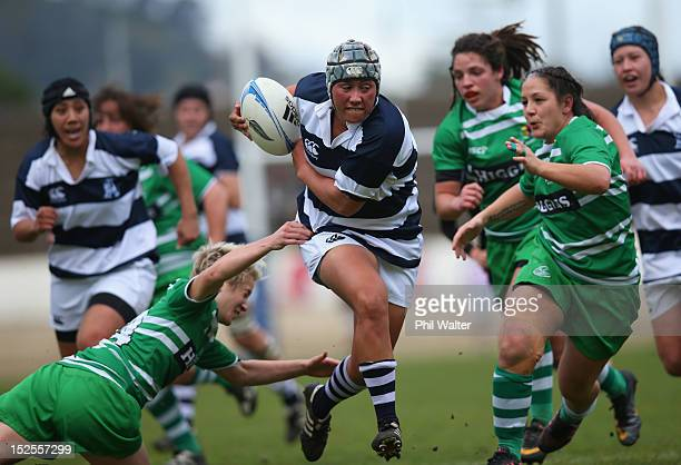 Aroha Savage of Auckland is tackled by Wairakau Greig of Manawatu during the round three Women's Provincial Championship match between Auckland and...