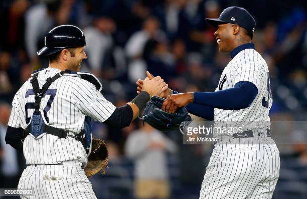 Aroldis Chapman and Austin Romine of the New York Yankees celebrate after defeating the Chicago White Sox at Yankee Stadium on April 17 2017 in the...