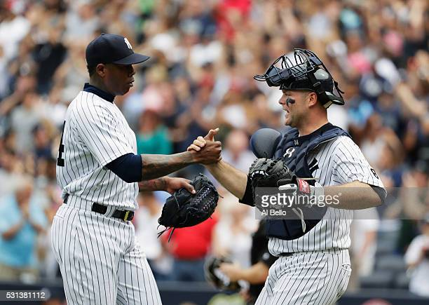 Aroldis Chapman and Brian McCann of the New York Yankees celebrate a 21 win against the Chicago White Sox during their game at Yankee Stadium on May...